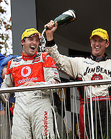 Steven Johnson douses Race Two winner Jamie Whincup in champagne after his win during Day Three of the Hamilton 400 Aussie V8 Supercars Round Two at Frankton, Hamilton, New Zealand on Sunday, 19 April 2009. Photo: Dave Lintott / lintottphoto.co.nz