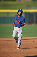 AZL Rangers Keyber Rodriguez (22) rounds the bases after hitting a home run during an Arizona League game against the AZL Athletics Gold on July 15, 2019 at Hohokam Stadium in Mesa, Arizona. The AZL Athletics Gold defeated the AZL Rangers 9-8 in 11 innings. (Zachary Lucy/Four Seam Images)