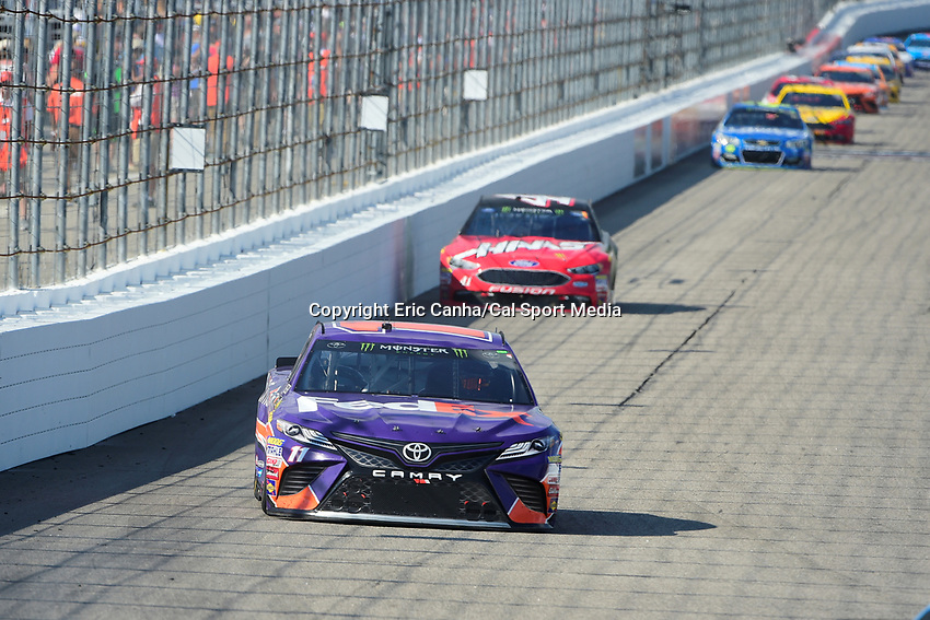 July 16, 2017 - Loudon, New Hampshire, U.S. - Denny Hamlin, Monster Energy NASCAR Cup Series driver of the FedEx Office Toyota (11), heads into turn 1 at the NASCAR Monster Energy Overton's 301 race held at the New Hampshire Motor Speedway in Loudon, New Hampshire. Larson placed first in the qualifier. Eric Canha/CSM