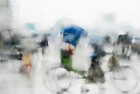 BANGLADESH, blurred bicycle rickshaw seen through wet window