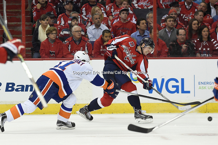 April 15, 2015 - Washington D.C., U.S. - Washington Capitals center Evgeny Kuznetsov (92) takes a shot during game 1 of the  NHL Eastern Conference Quarter finals between the New York Islanders and the Washington Capitals held at the Verizon Center in Washington DC. The Islanders defeat the Capitals  4-1 in regulation time. Eric Canha/CSM