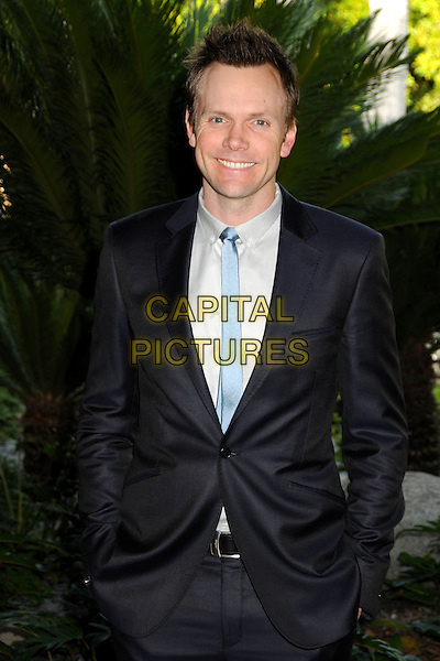 JOEL McHALE .NBC Universal Press Tour Cocktail Party held at the Langham Hotel, Pasadena, California, USA, 10th January 2010..half length blue tie suit navy hands in pockets .CAP/ADM/BP.©Byron Purvis/AdMedia/Capital Pictures.