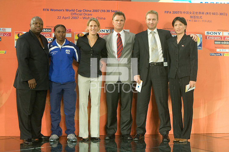 USWNT forward Kristine Lilly and head coach Greg Ryan (center) stand with other representative of Group B after the 2007 FIFA Women's World Cup Draw on April 22, 2007 in Wuhan, China.