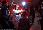 The wedding party dances under the every present wedding photographer eye.