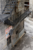 The back door of 65 Chinese Restaurant & Bakery leads out into the alley. An old metal fire escape stands ready for use on the side of the building in Chicago, Illinois on August 5, 2008.