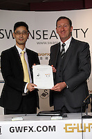 Pictured L-R:  Albert Sin, Goldenway Precious Metal operation manager, chairman Huw Jenkins at the official launch of the 2013-2014 Swansea City Football Club kit launch at the Liberty Stadium, Swansea, south Wales. Friday 28th of June 2013