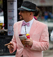 LOUISVILLE, KY - MAY 05: A man smokes a cigar and drinks an Oaks Lily on Kentucky Oaks Day at Churchill Downs on May 5, 2017 in Louisville, Kentucky. (Photo by Jesse Caris/Eclipse Sportswire/Getty Images)