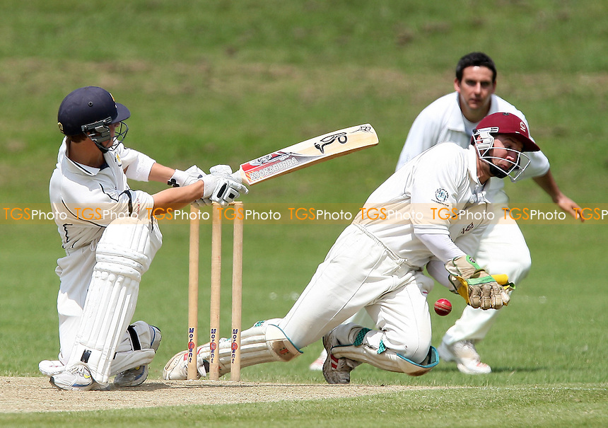 Jacob Thompson in batting action for Ardleigh Green as Ben Cocklin keeps wicket for Brentwood - Ardleigh Green CC vs Brentwood CC - Essex Cricket League - 13/06/09 - MANDATORY CREDIT: Gavin Ellis/TGSPHOTO - Self billing applies where appropriate - 0845 094 6026 - contact@tgsphoto.co.uk - NO UNPAID USE.