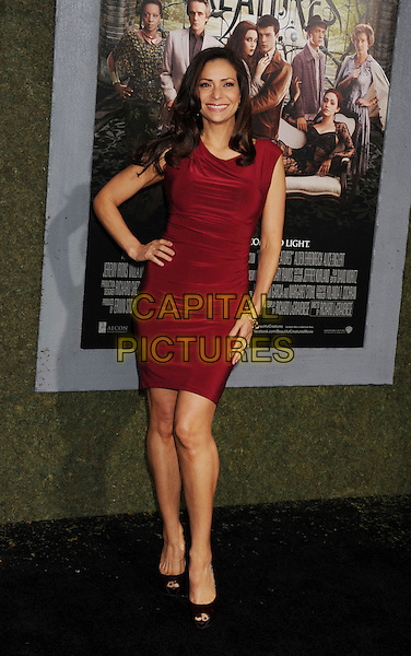 "Constance Marie.arriving at the Los Angeles premiere of ""Beautiful Creatures"" at TCL Chinese Theatre in Hollywood, California, USA, .February 6th, 2013..full length red dress peep toe shoes black  hand on hip .CAP/ROT/TM.©Tony Michaels/Roth Stock/Capital Pictures"