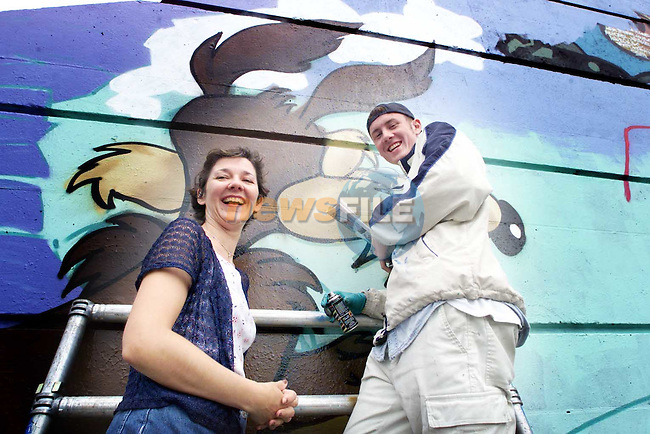 Siobhan Woods, Drogheda Concentrates and Alan Hester at the mural painting under the Bridge of Peace..Picture Paul Mohan Newsfile