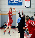 WOLCOTT, CT-031418JS017 Wamogo's Garrett Sattazahn (12) celebrates with hie father, assistant coach Jeremiah Sattazahn,  after a time out was called during their win over East Hampton in the  Division V semifinal game Wednesday at Wolcott High School. <br />