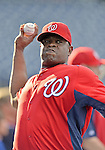 21 September 2012: Washington Nationals bullpen catcher Nilson Robledo tosses during batting practice prior to a game against the Milwaukee Brewers at Nationals Park in Washington, DC. The Nationals fell to the Brewers 4-2 in the first game of their 4-game series. Mandatory Credit: Ed Wolfstein Photo