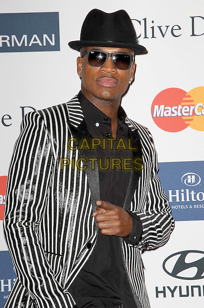 Ne-Yo (Shaffer Chimere Smith).Clive Davis And The Recording Academy's 2013 GRAMMY Salute To Industry Icons Gala held at The Beverly Hilton Hotel, Beverly Hills, California, USA..February 9th, 2013.half length black shirt hat suit jacket stripe hand finger pointing sunglasses shades .CAP/ADM/KB.©Kevan Brooks/AdMedia/Capital Pictures.
