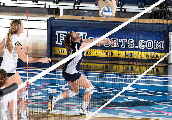 Florida International University women's volleyball libero/defensive specialist Adriana McLamb (10) plays against  the University of Central Florida which won the match 3-0 on September 17, 2015 at Miami, Florida.