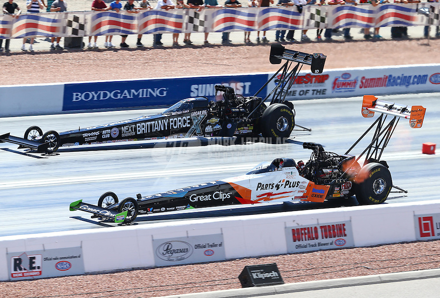 Apr 12, 2015; Las Vegas, NV, USA; NHRA top fuel driver Clay Millican (near lane) races alongside Brittany Force during the Summitracing.com Nationals at The Strip at Las Vegas Motor Speedway. Mandatory Credit: Mark J. Rebilas-