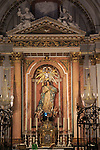 Altar statue ornately decorated inside cathedral church building building, city of Valencia, Spain