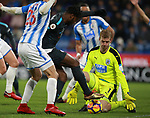 Jonas Lossl of Huddersfield Town  saves at the feet of Michy Batshuayi of Chelsea during the premier league match at the John Smith's Stadium, Huddersfield. Picture date 12th December 2017. Picture credit should read: Simon Bellis/Sportimage