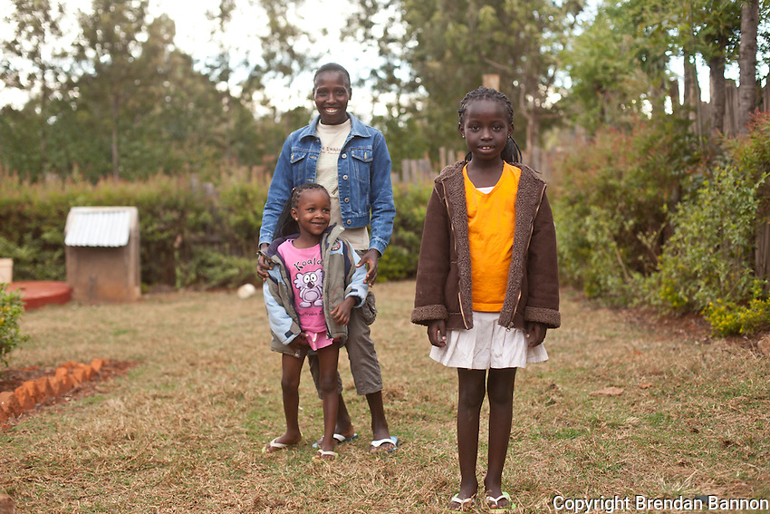 Florence Kipligat, one of Kenya's leading women marathon runners at home with her daughters Asha and  Faith. Kipligat trains with coach Renato Canova in the high altitude of Iten, Kenya.
