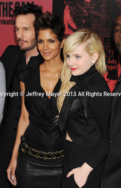 HOLLYWOOD, CA - MARCH 05: Michael Eklund, Halle Berry and Abigail Breslin arrive at the 'The Call' - Los Angeles Premiere at ArcLight Hollywood on March 5, 2013 in Hollywood, California.