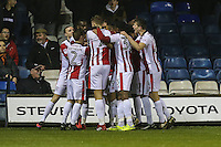 Will Boyle of Cheltenham Town celebrates with team mates after he scores the opening goal of the game during the Sky Bet League 2 match between Luton Town and Cheltenham Town at Kenilworth Road, Luton, England on 31 January 2017. Photo by David Horn / PRiME Media Images