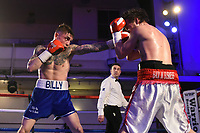 Billy Allington (blue shorts) defeats Rhys Saunders during a Boxing Show at the Camden Centre on 10th March 2018