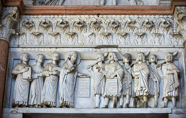 Late medieval relief sculpture depicting St Martin  on the Facade of the Cattedrale di San Martino,  Duomo of Lucca, Tunscany, Italy,
