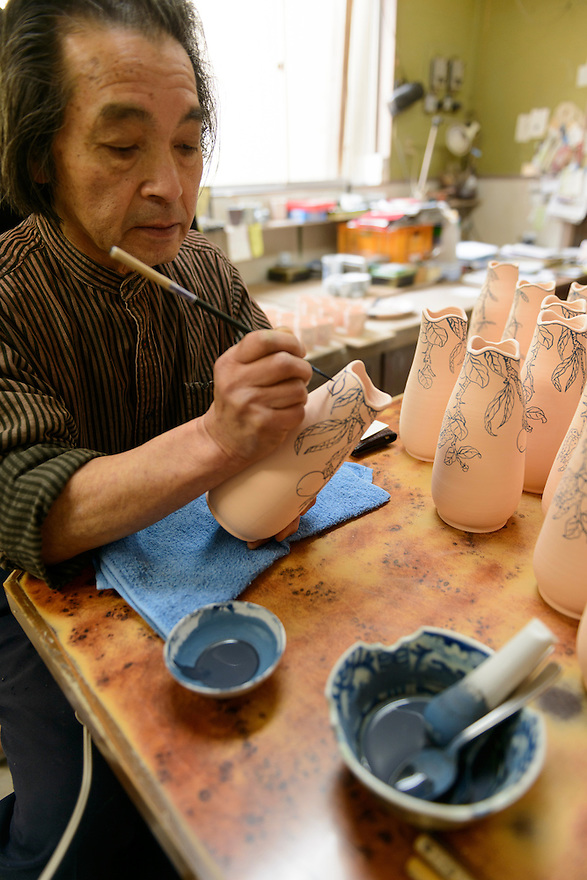 Ceramicist Hyodo Ito at work. Ginzan Onsen, Yamagata Prefecture, Japan, April 13, 2016. Once a sliver-mining town, Ginzan Onsen in Yamagata Prefecture is now one of Japan's best-known and most picturesque hot spring resorts. Its Taisho-period architecture and retro atmosphere is said to have been an inspiration for Hayao Miyazaki's Oscar-winning animated film, Spirited Away.