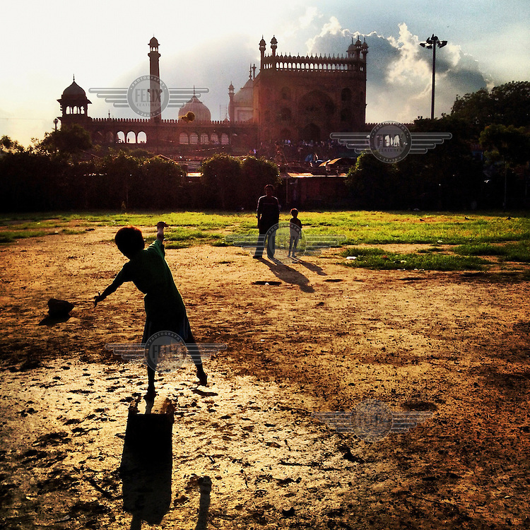 Street children throw a broken tennis ball in the late afternoon in Urdu Park where they live. The open space is adjacent to the Jama Masjid in Old Delhi.