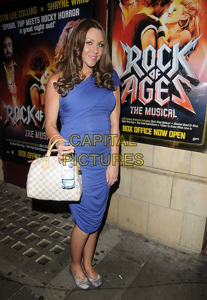 "MICHELLE HEATON.The ""Rock Of Ages The Musical"" gala night, Shaftesbury theatre, Shaftesbury Avenue, London, England..28th September 2011.full length blue one shoulder dress pregnant grey gray white check bag purse .CAP/CAN.©Can Nguyen/Capital Pictures."