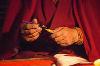 Monk doing calligraphy at Ganden Monastery, Tibet