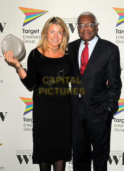DEBORAH TURNESS (the BBC News & Factual Award winner) & SIR TREVOR McDONALD.The Target Women in Film & TV Awards, London Hilton hotel, Park Lane, London, England..December 5th, 2008.half length black dress ribbon bow suit red tie glasses award trophy macdonald.CAP/CAN.©Can Nguyen/Capital Pictures.