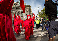 The Red Brigade, also known as the Invisible circus<br /> .<br /> Environmental activists from Extinction Rebellion protest in London on 09 October 2019 in London, England.<br /> .<br /> Protesters plan to blockade the London government district for a two week period, as part of 'International Rebellion' taking place in over 60 cities around the world, calling for decisive and immediate action from governments in the face of climate and ecological emergency. <br /> .<br /> Photo by Andy Rowland.