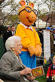 "Former first lady Barbara Bush reads, ""Aurther New Puppy,"" as a mascot of Aurther looks at the annual White House Easter Egg Roll March 24, 2008 on the South Lawn of the White House in Washington, DC. The Easter Egg Roll is a traditional all-American event held on the White House lawn each year since 1878, where kids compete by using a giant wooden spoon to push and egg.<br /> Credit: Ken Cedeno / Pool via CNP"