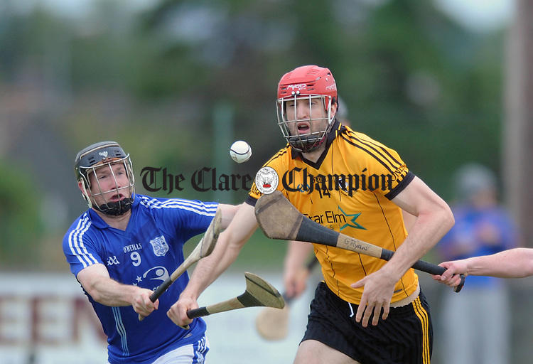 Darach Honan eyes posession under pressure from Cratloe's Martin Óige Murphy. Photograph by Declan Monaghan