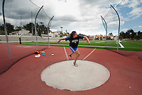 Kelly Young practices throwing the discus on Patterson Field, May 18, 2011. (Photo by Marc Campos, Occidental College Photographer)