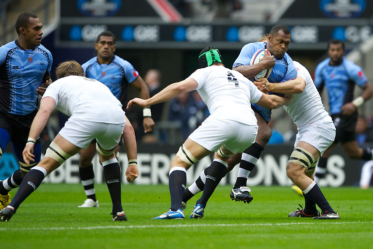 Vereniki Goneva of the Flying Fijians is tackled by Geoff Parling (left) and Chris Robshaw of England during the QBE International between England and Fiji at Twickenham on Saturday 10th November 2012 (Photo by Rob Munro)