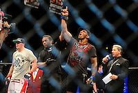 Oct. 29, 2011; Las Vegas, NV, USA; UFC fighter Francis Carmont (right) celebrates as referee Herb Dean (center) announces him the winner over Chris Camozzi during a middleweight bout during UFC 137 at the Mandalay Bay event center. Mandatory Credit: Mark J. Rebilas-