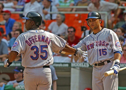 Washington, D.C. - July 4, 2005 --  New York Mets Center Fielder Carlos Beltran (15), right, congratulates infielder Jose Offerman (35), left, as he scores one of their 3 runs in the 9th inning in the game against the Washington Nationals at RFK Stadium in Washington, D.C. on July 4, 2005.  The Mets won 5 - 2..Credit: Ron Sachs / CNP.(RESTRICTION: NO New York or New Jersey Newspapers or newspapers within a 75 mile radius of New York City)