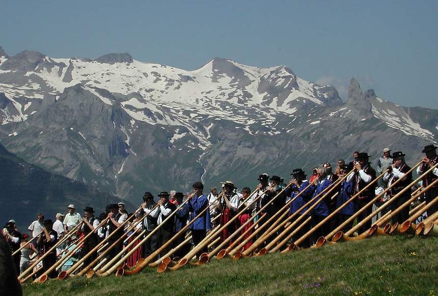Hundreds of Alpen Horn players gather for a mass demonstration of Alpen Horns in Murren, Switzerland. Ernie Mastroianni photo.