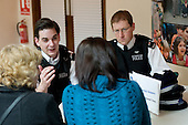 Residents speak to members of the neighbourhood policing team at a regular Monday afternoon drop-in advice session at the Beethoven Centre, Queen's Park.