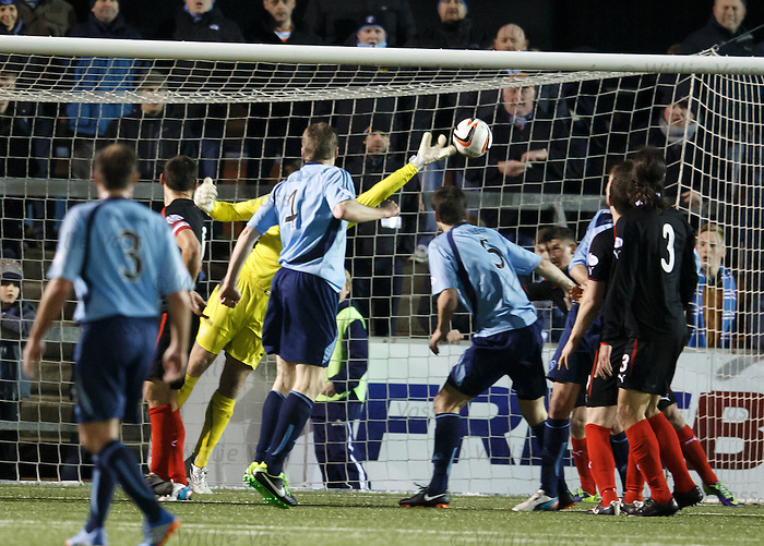 Steve Simonsen flicks out a paw to deny Forfar a goal