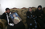 Mother of Palestinian prisoner Raed Abu Hamad, who died in an Israeli jail, holds his picture at her home in Al-Azariya on the outskirts of Jerusalem on April 17, 2010. Palestinians held rallies and vigils in an annual day of support for the thousands of Palestinians held in Israeli prisons, a day after Abu Hamad died in custody. Prisons service officials, quoted in the Israeli media, said Abu Hamad, 31, had a history of medical problems and that his death was being investigated. Photo by Mohamar Awad