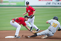 Kannapolis Intimidators shortstop Cleuluis Rondon (5) applies the tag to JaCoby Jones (10) of the West Virginia Power as he attempts to steal second base at CMC-Northeast Stadium on April 29, 2014 in Kannapolis, North Carolina.  The Intimidators defeated the Power 1-0.  (Brian Westerholt/Four Seam Images)