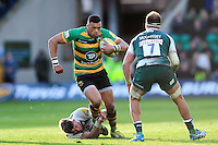 Luther Burrell of Northampton Saints takes on the Leicester Tigers defence. Aviva Premiership match, between Northampton Saints and Leicester Tigers on April 16, 2016 at Franklin's Gardens in Northampton, England. Photo by: Patrick Khachfe / JMP