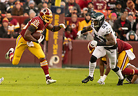 Washington Redskins running back Adrian Peterson (26) carries the ball in the first quarter against the Philadelphia Eagles at FedEx Field in Landover, Maryland on December 30, 2018.  He is pursued by Philadelphia Eagles outside linebacker Nigel Bradham (53). Photo Credit: Ron Sachs/CNP/AdMedia
