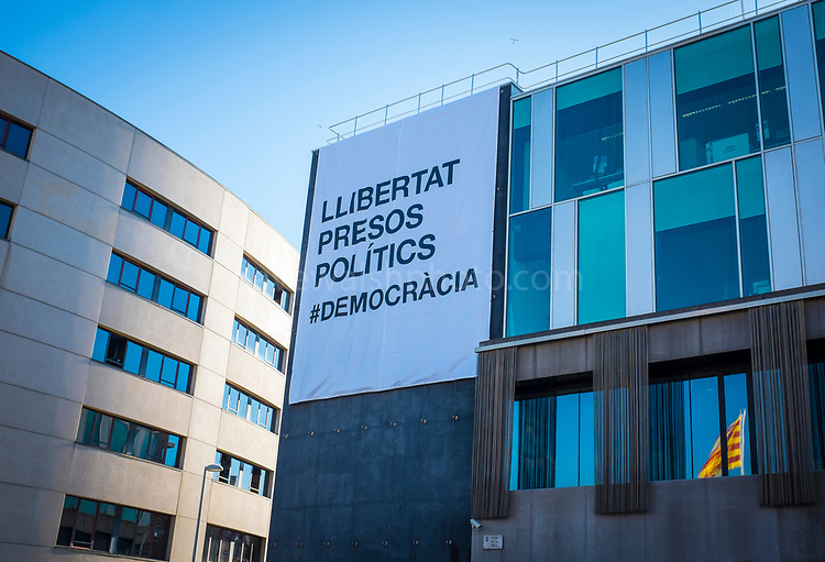 "New banner on the ajuntament - town hall of Sant Cugat del Valles, Barcelona, Catalonia, calling for ""llibertat presos politics"" - free political prisoners, after the jailing by the Spanish government of Catalan government ministers and civil society leaders after the declaration of the Republic of Catalonia. The original banner was torn down and destroyed by extreme right wing protestors on November 6th, 2017."