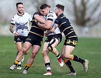 TORONTO, ON - MAY 05:  Nick Rawsthorne #23 of the Toronto Wolfpack is tackled in the second half of a Betfred Championship match against the Swinton Lions at Fletcher's Fields on May 5, 2018 in Toronto, Canada.  (Photo by Vaughn Ridley/SWpix.com)