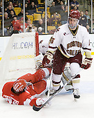 Sean Escobedo (BU - 21), Patrick Wey (BC - 6) - The Boston College Eagles defeated the Boston University Terriers 3-2 (OT) in their Beanpot opener on Monday, February 7, 2011, at TD Garden in Boston, Massachusetts.