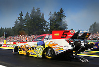 Aug. 3, 2014; Kent, WA, USA; NHRA funny car driver Cruz Pedregon during the Northwest Nationals at Pacific Raceways. Mandatory Credit: Mark J. Rebilas-USA TODAY Sports