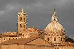 A bell tower and a church dome along via dei Fori Imperiali in Rome, Italy.